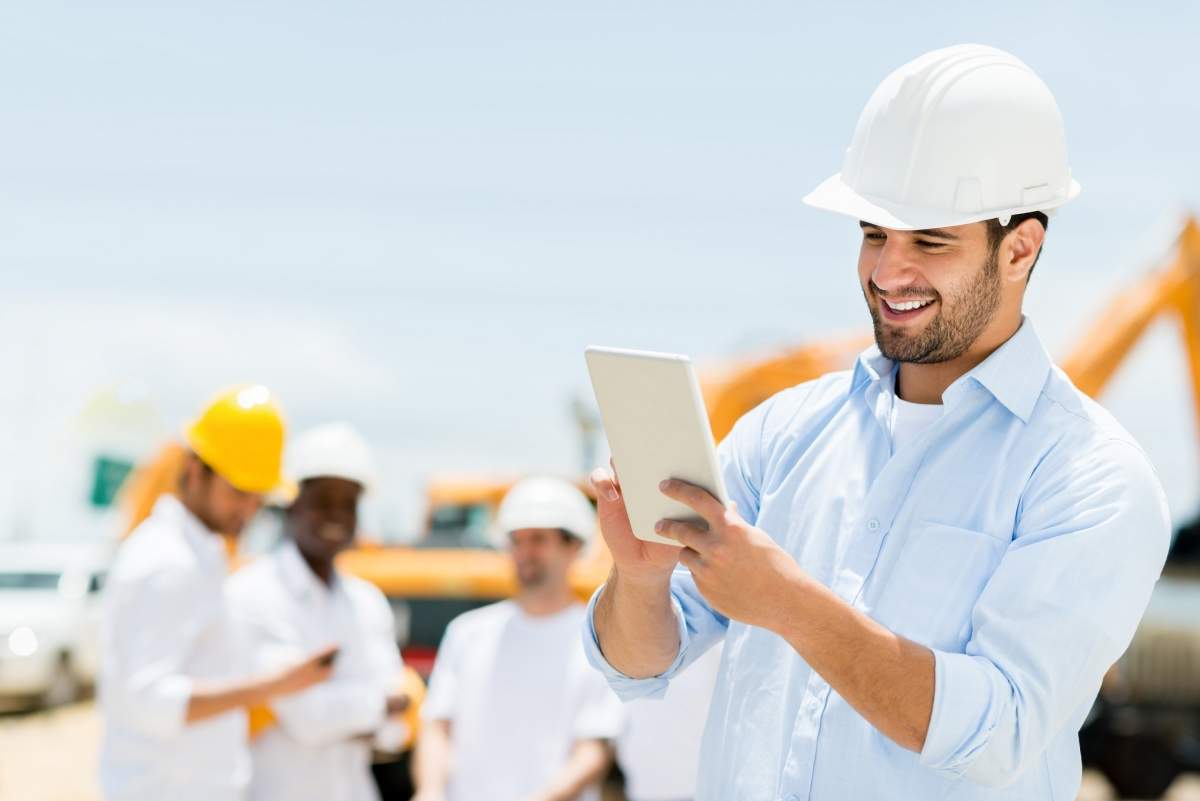 Male engineer at a construction site with a tablet computer